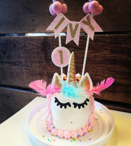 Unicorn Cake: Whipped cream cheese frosting, non-edible unicorn topper (style may vary), scalloped style hair on sides and back of the cake. Unicorn hair can be a single color or any color combo.
